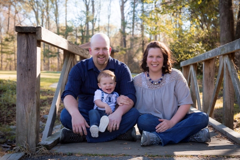 Family poses for a photo shoot at Lake Benson Park in Garner NC