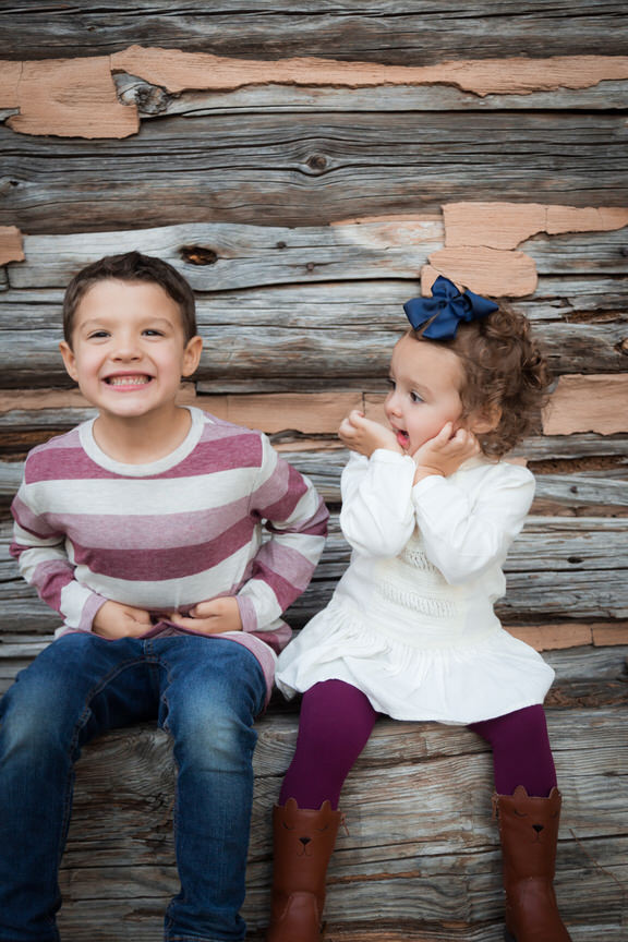 Brother and Sister giggle during their family photo session