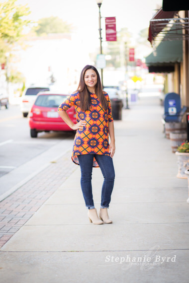 A mom poses in historic downtown Apex during a LuLaRoe fashion photography session.